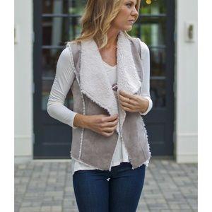 Grey fur lined vest